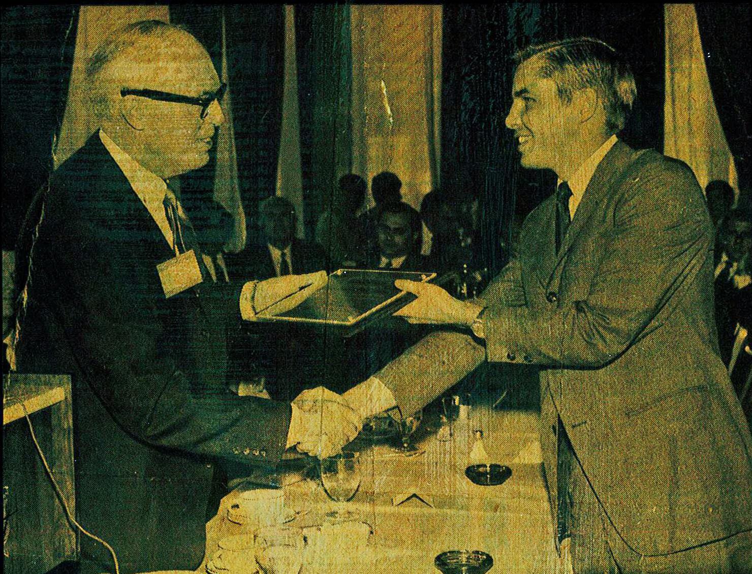 Douglas Schmidt receiving Award of Merit from American Bar Association.